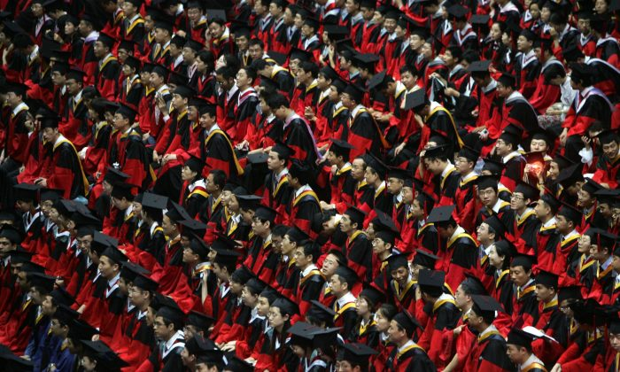Students during a graduation ceremony held  at Tsinghua University in Beijing, China on July 18, 2007. (Photo by China Photos/Getty Images)
