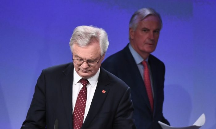 Britain's chief Brexit negotiator David Davis (L) and EU's chief Brexit negotiator Michel Barnier arrive to address the media following a sixth round of Brexit talks at the European Union Commission building in Brussels on November 10, 2017. (Emmanuel Dunand/AFP/Getty Images)