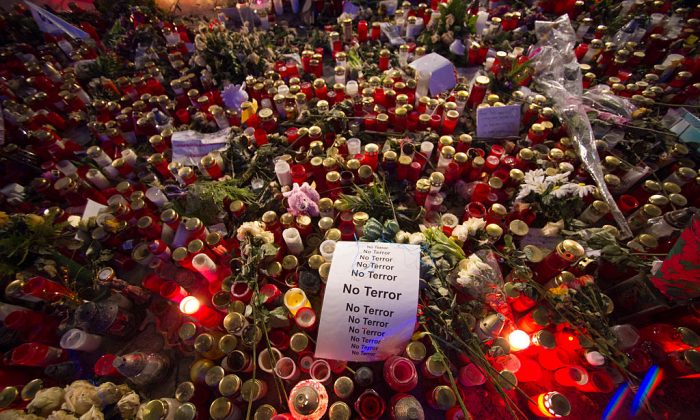 """A sign that reads """"No Terror"""" lies on candles and flowers at a memorial for the Christmas market terror attack victims at Breitscheidplatz in Germany on Jan. 19, 2017. On Dec. 19, 2016 Anis Amri, a Tunisian radical, drove a heavy truck into a crowded Christmas market at Breitscheidplatz, killing 12 people and injuring 50. (Steffi Loos/Getty Images)"""