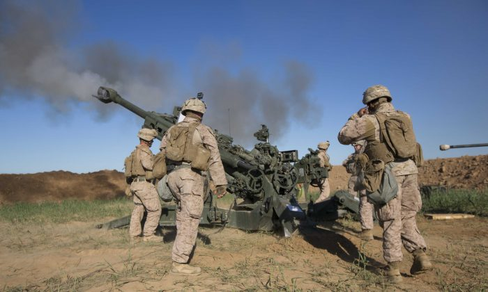 Soldiers fire on ISIS infiltration route in support of Operation Inherent Resolve in Iraq on March 18, 2016. (U.S. Marine Corps photo by Cpl. Andre Dakis/26th MEU Combat Camera/FOUO)