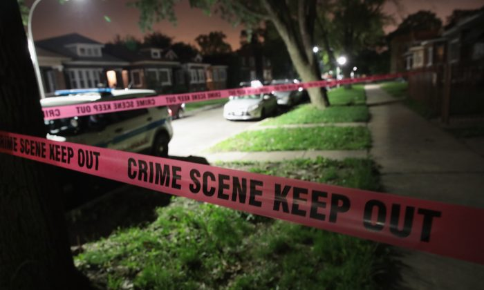 Police tape in a stock photo (Scott Olson/Getty Images)