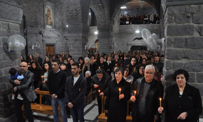 Syrian Christians attend a Good Friday mass at the Saint Mary church of the Holy Belt in the old part of the country's central city of Homs on April 14, 2014. (STR/AFP/Getty Images)