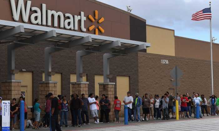 People wait in line for a Walmart store to open in Houston, Texas on August 30, 2017. (Mark Ralston/AFP/Getty Images)
