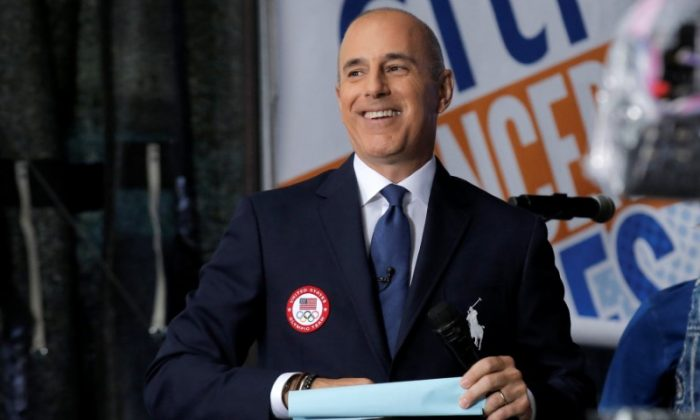 NBC's 'Today' show anchor Matt Lauer models the official Opening Ceremony outfit that Team USA members will wear by Polo Ralph Lauren in New York City, U.S., July 29, 2016.  (Reuters/Brendan McDermid  Picture Supplied by Action Images)
