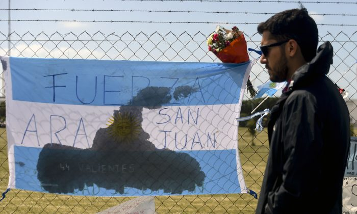 A relative of a missing Argentine submarine crew member is pictured outside Argentina's Navy base in Mar del Plata, Argentina, on Nov. 24. (EITAN ABRAMOVICH/AFP/Getty Images)