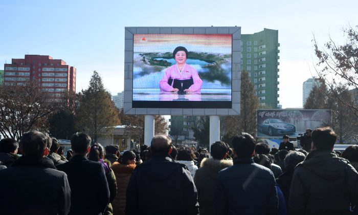 Pyongyang residents watch a big screen near the Pyongyang Railway Station showing the news on the successful launch of the new intercontinental ballistic missile Hwasong-15 in Pyongyang on Nov. 29, 2017.  North Korean leader Kim Jong Un said on Nov. 29 his country had achieved full nuclear statehood after successfully testing a new missile capable of hitting anywhere in the United States. (KIM WON-JIN/AFP/Getty Images)