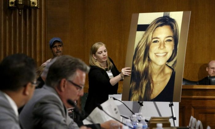 A photo of murder victim Kate Steinle is placed on an easel as her father Jim Steinle (2nd L) prepares to testify about her murder during a hearing of the Senate Judiciary Committee on U.S. immigration enforcement policies, on Capitol Hill in Washington, DC, U.S. on July 21, 2015.  (REUTERS/Jonathan Ernst/File Photo)