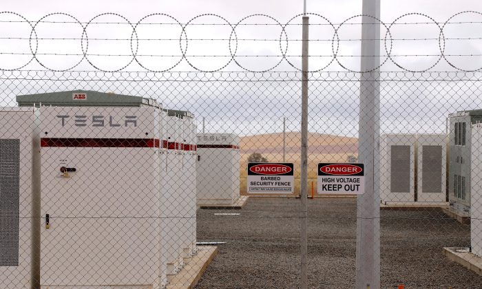 Warning signs adorn the fence surrounding the compound housing the Hornsdale Power Reserve, featuring the world's largest lithium ion battery made by Tesla, during the official launch near the South Australian town of Jamestown, in Australia, Dec. 1, 2017. (Reuters/David Gray