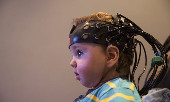 Scientists study brain activity in a 9-month-old baby. (Oli Scarff/Getty Images)