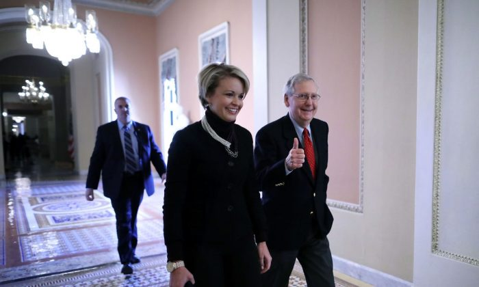 Senate Majority Leader Mitch McConnell (R-KY) gives a thumbs-up as he and his Director of Operations Stephanie Muchow head for the Senate floor at the U.S. Capitol in Washington, DC. on Dec. 1, 2017. Senate Republicans moved one step closer to delivering a tax reform bill to President Donald Trump before Christmas.  (Chip Somodevilla/Getty Images)