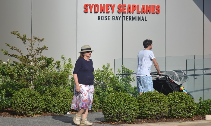 Visitors at the entrance to the Sydney Seaplanes terminal in Rose Bay, Sydney, on Jan. 1, 2018. Six people were killed when one of the company's seaplane crashed into a river on New Year's Eve. (Peter Parks/AFP/Getty Images)