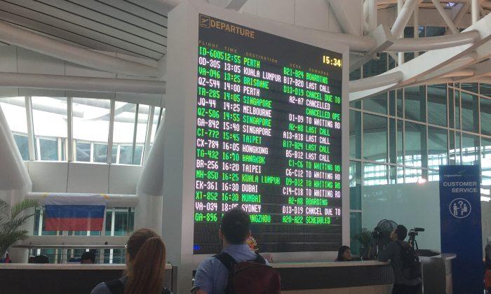 International passengers are seen near the flight information board at Ngurah Rai Bali International Airport, Kuta, Bali, Indonesia December 2, 2017. (Reuters/Kanupriya Kapoor)