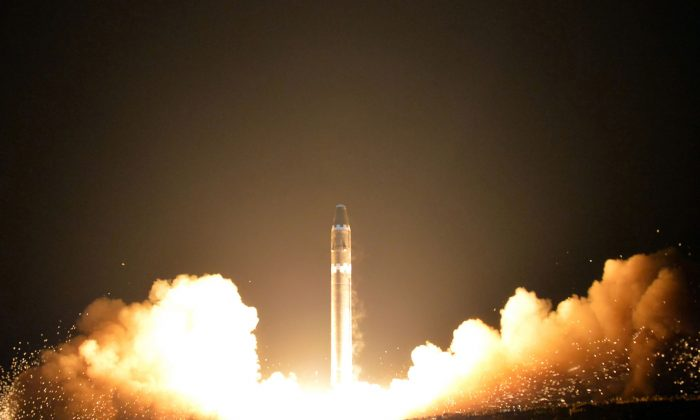 Photo released on Nov. 30 by North Korea's official Korean Central News Agency (KCNA) shows launching of the Hwasong-15 missile, which is capable of reaching all parts of the United States.