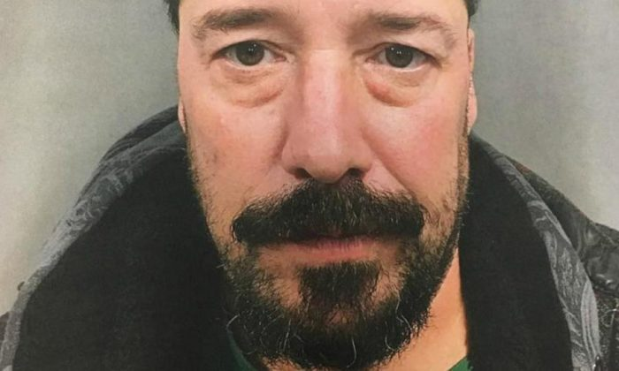 John Gomes, 51, accidently burned down three buildings and damaged at least two dozen others while trying to forge a medieval weapon in his back yard. (Handout photo)