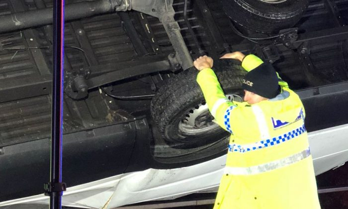 PC Martin Willis clung on to a van that was hanging off a motorway with his bare hands before emergency services arrived. (West Yorshire Police)