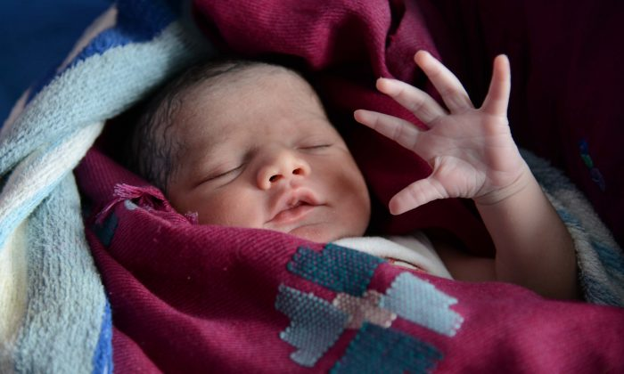 A newborn baby is pictured in India on July 11, 2013. (Narinder Nanu/AFP/Getty Images)