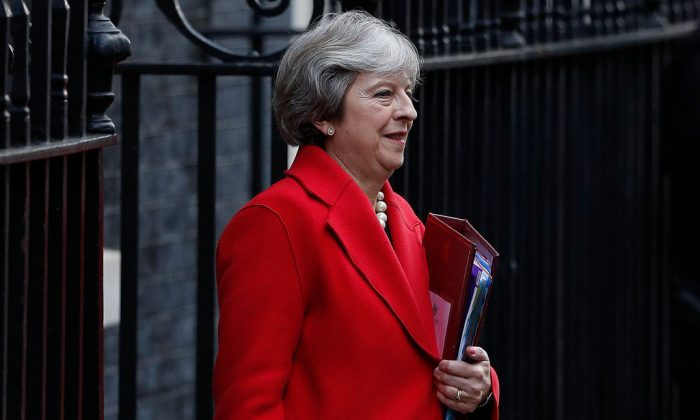 Britain's Prime Minister Theresa May leaves 10 Downing Street in central London on Nov. 22, 2017, before heading to the House of Commons. (Adrian Dennis/AFP/Getty Images)