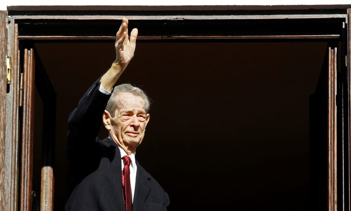 Romania's former King Michael waves during a ceremony celebrating both his 92nd birthday, which fell on October 25, and his name day at Elisabeta Palace in Bucharest, on Nov. 8, 2013.  (REUTERS/Bogdan Cristel/File Photo)