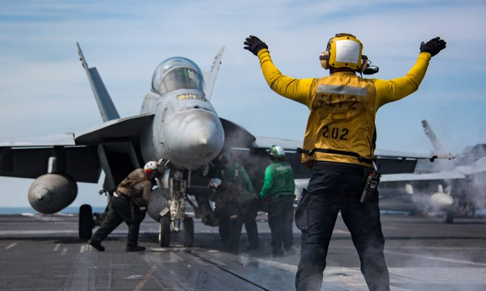 """U.S. Navy sailors conduct flight operations Tuesday, May 2, 2017 aboard the Nimitz-class aircraft carrier USS Carl Vinson (CVN 70) in the western Pacific Ocean. U.S. Navy's top leadership said on Monday that the size of the United States Navy is now at its """"smallest in a century,"""" while still facing ever-rising threats. (Sean M. Castellano/US Navy via Getty Images)"""