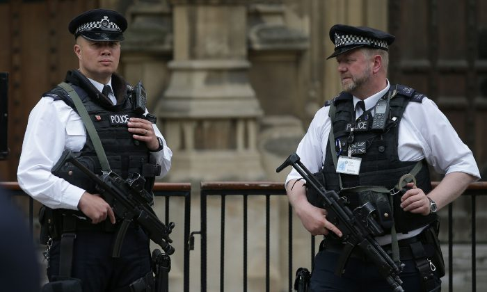 Armed British Police officers stand on duty outside of the Houses of Parliament in Westminster, central London on May 23, 2017, following the terror attack at the Ariana Grande concert at the Manchester Arena in Manchester on May 22. (Daniel Leal-Olivas/AFP/Getty Images)