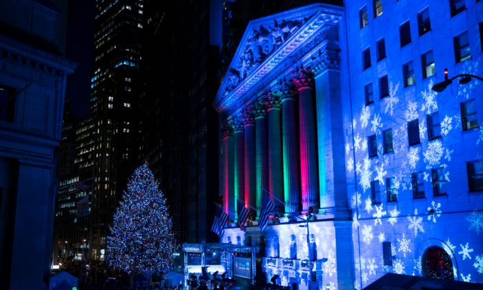 The New York Stock Exchange (NYSE) and a Christmas tree are illuminated in the Financial District, Nov. 30, 2017 in New York City. (Drew Angerer/Getty Images)