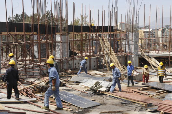 Chinese workers of the China State Construction Engineering Corporation (CSCEC) work in Addis Ababa, the capital of Ethiopia, on Jan. 30, 2010. (Simon Maina/AFP/Getty Images)