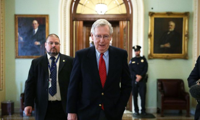 Senate Majority Leader Sen. Mitch McConnell (R-KY) (C) walks from the Senate chamber to his office December 1, 2017 at the Capitol in Washington. (Alex Wong/Getty Images)