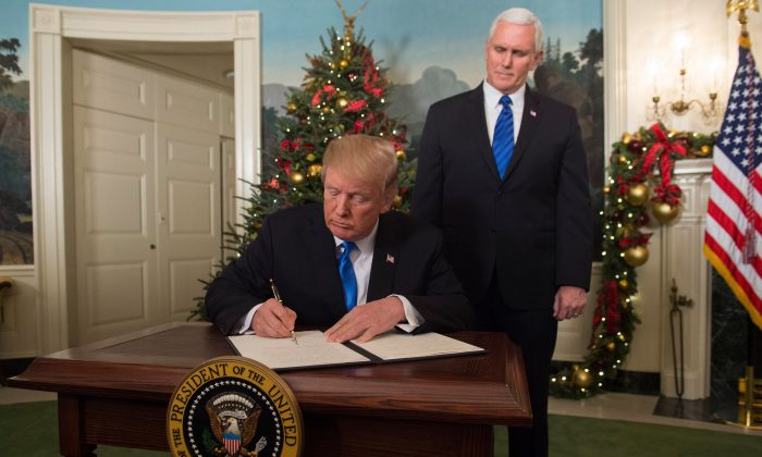 President Donald Trump signs a proclamation after he delivered a statement on Jerusalem from the Diplomatic Reception Room of the White House on Dec. 6, 2017. (SAUL LOEB/AFP/Getty Images)