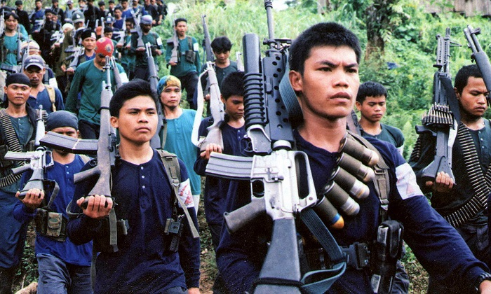 This 2004 file photo shows a communist New People's Army (NPA) guerrilla unit marching in formation during a press visit to their jungle camp in the rebel's mountain stronghold in southern Mindanao. Philippine President Rodrigo Duterte has classified the Communist Party of the Philippines and its armed wing the NPA as a terrorist organization. (AFP/AFP/Getty Images)