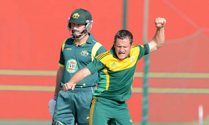 PRETORIA, SOUTH AFRICA - AUGUST 06: Roelof van der Merwe of South Africa A celebrates the wicket of Moises Henriques of Australia A during the 1st ODI match between South Africa A and Australia A from Tuks Oval on August 06, 2013 in Pretoria, South Africa. (Photo by Lee Warren/Gallo Images/Getty Images)