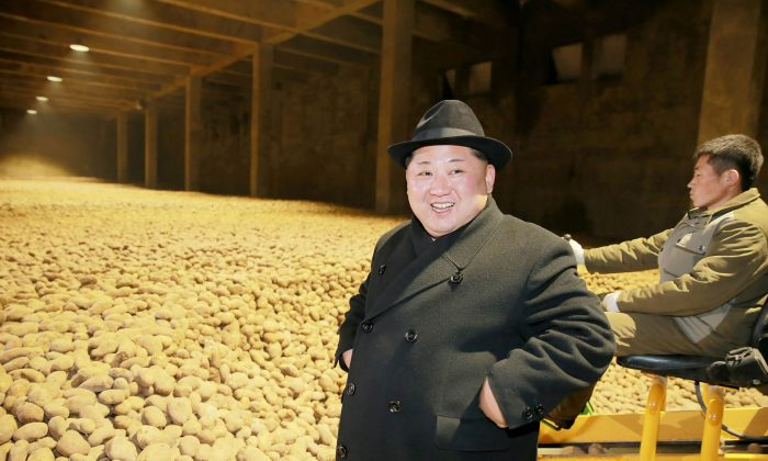 North Korean leader Kim Jong-un (L) inspects the newly-built Samjiyon potato farina production factory in Ryanggang Province, North Korea on Dec. 6, 2017. (STR/AFP/Getty Images)