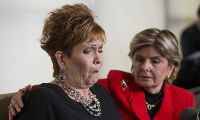 Attorney Gloria Allred (R) hugs Beverly Young Nelson as she reacts during a press conference on November 13, 2017, in New York. (EDUARDO MUNOZ ALVAREZ/AFP/Getty Images)