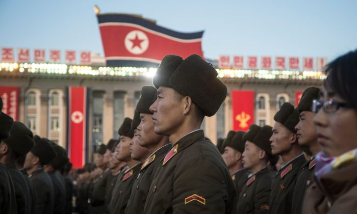 North Korean soldiers attend a mass rally to celebrate North Korea's declaration on Nov. 29 that it had achieved full nuclear statehood, on Kim Il-Sung Square in Pyongyang on Dec. 1, 2017.  North Korea maintains a large army, but soldiers are not being given enough food and morale has plummeted, say sources inside the country. (KIM WON-JIN/AFP/Getty Images)