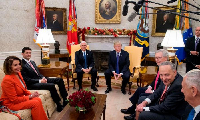 U.S. President Donald Trump, alongside Vice President Mike Pence (3L), meets with Congressional leadership including Senate majority leader Mitch McConnell (3R) (R-Ky.), Senate minority leader Chuck Schumer (2R) (D-NY), Speaker of the House Paul Ryan (2nd L) (R-Wis.), and House Minority Leader Nancy Pelosi (L) (D-Calif.), and Secretary of Defense Jim Mattis (R), in the Oval Office at the White House in Washington, DC, Dec. 7, 2017. (SAUL LOEB/AFP/Getty Images)