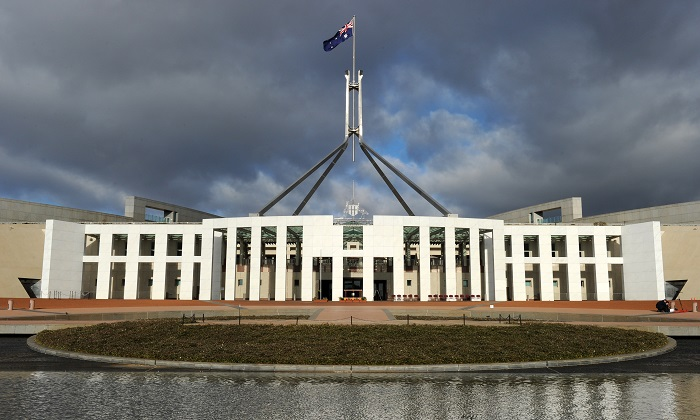 The Australian national flag flies over Parliament House in Canberra in this file image. (Torsten Blackwood/AFP/Getty Images)