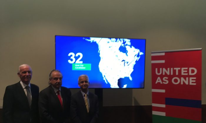 (L-R) Canadian Soccer Association president Steve Reed, Mexican Football Federation president Decio de Maria, and Sunil Gulati, U.S. soccer president pose for photos after a press conference in Toronto on Dec. 9, 2017. (Rahul Vaidyanath/The Epoch Times)