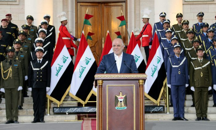 Iraqi Prime Minister Haider al-Abadi delivers a speech in Baghdad, Iraq, December 9, 2017. (Iraqi Prime Minister Media Office/Handout via Reuters)