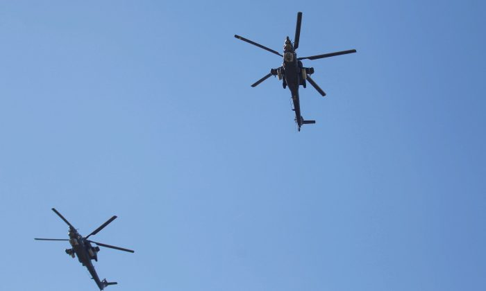 Iraqi helicopters fly during an Iraqi military parade in Baghdad, Iraq December 10, 2017. (Reuters/Khalid al-Mousily)