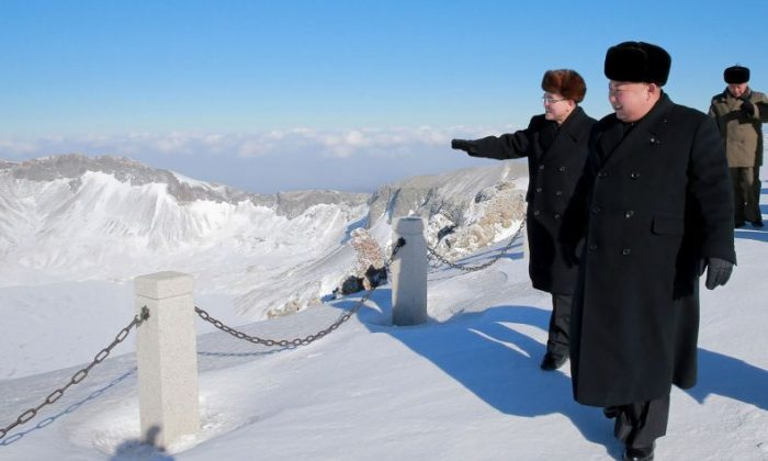 """This undated picture released from North Korea's official Korean Central News Agency (KCNA) purportedly shows North Korean dictator Kim Jong Un """"visiting"""" Mount Paektu in Ryanggang Province on Dec. 09, 2017. Notice that there are no footprints behind Kim. (AFP PHOTO / KCNA VIS KNS )"""
