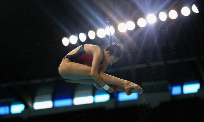Han Wang of China dives in the Women's 3m Springboard finals during the FINA/NVA Diving World Series 2014 at the Hamdan Sports Complex in Dubai on March 21, 2014. (Warren Little/Getty Images)