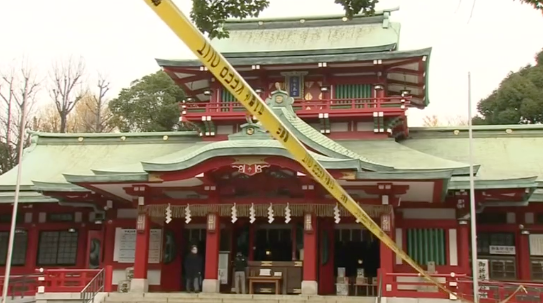 Police tape around Tokyo's largest Shinto shrine which is now a crime scene. A Shinto priestess was stabbed by her younger brother on Thursday, Dec. 7, 2017, in what may have been a family feud. (Reuters/TV Tokyo)