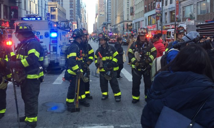 Firefighters staged outside the Port Authority Bus Terminal on Dec. 11, 2017, in New York City. (NTD Television)