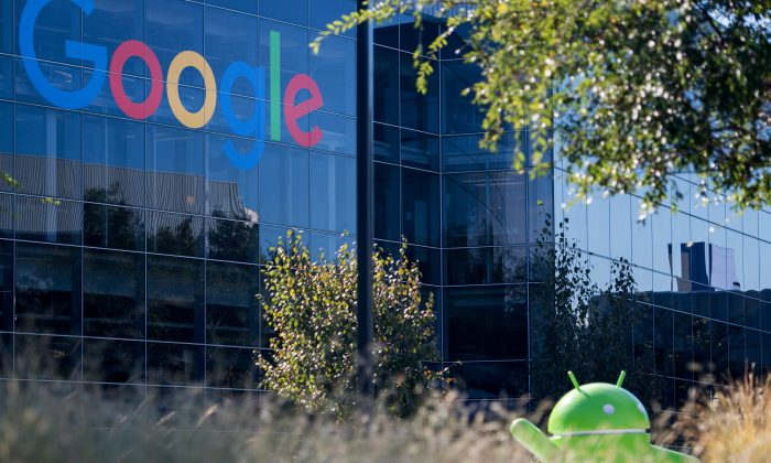 A Google logo and Android statue are seen at the Googleplex in Menlo Park, California on Nov. 4, 2016. (Josh Edelson/AFP/Getty Images)