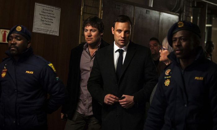 South African Paralympian Oscar Pistorius (C-R) arrives at the Pretoria High Court for sentencing procedures in his murder trial on July 6, 2016. (John Wessels/AFP/Getty Images)