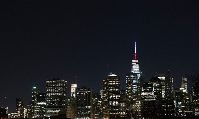 One World Trade Center's spire is shown lit in French flags colors of white, blue and red in solidarity with France after tonight's terror attacks in Paris on Nov. 13, 2015 in New York City. On Dec. 11, 2017, New York Gov. Cuomo ordered the spire be lit in red, white, and blue in response to that day's terror attack in New York City (Daniel Pierce Wright/Getty Images)
