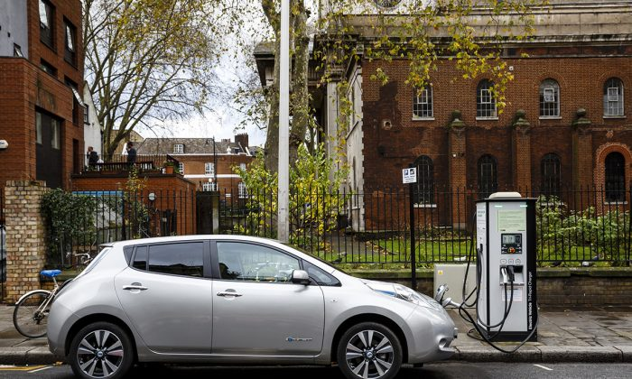 An electric car charging at a station. (Miles Willis/Stringer/Getty Images)