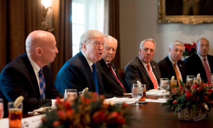 US President Donald Trump speaks about tax reform legislation during a lunch with lawmakers working on the tax reform conference committee in the Cabinet Room at the White House in Washington, DC, Dec. 13, 2017. (SAUL LOEB/AFP/Getty Images)