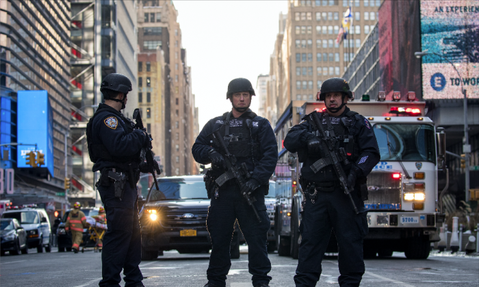 Police stand guard near the New York Port Authority Bus Terminal, the site of a pipe bomb explosion, in New York on Dec. 11, 2017. (Drew Angerer/Getty Images)