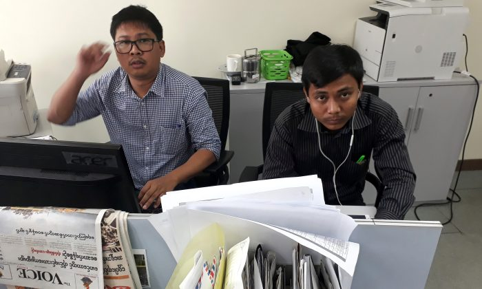 Reuters journalists Wa Lone (L) and Kyaw Soe Oo, who are based in Burma, pose for a picture at the Reuters office in Burma on Dec. 11, 2017. (Reuters/Antoni Slodkowski)