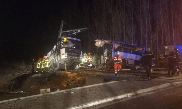 Rescue workers are seen on the site of collision between train and school bus in Millas, France Dec. 14, 2017 in this handout picture. (France Bleu Roussillon/Handout via Reuters)